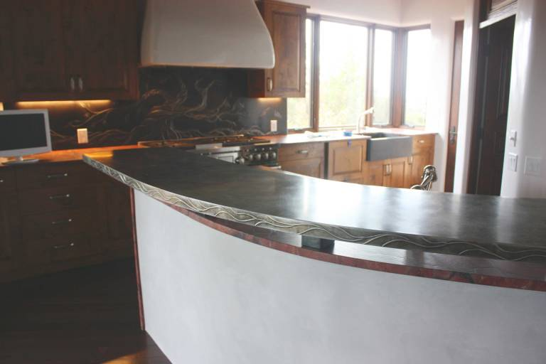 In the foreground is the zinc counter top with an embossed edging.