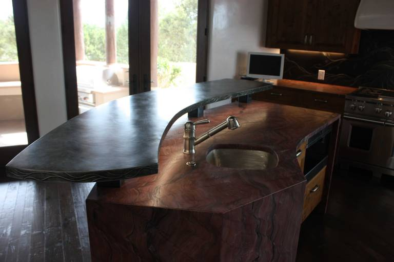 The zinc counter top suspended above the stone work and sink.