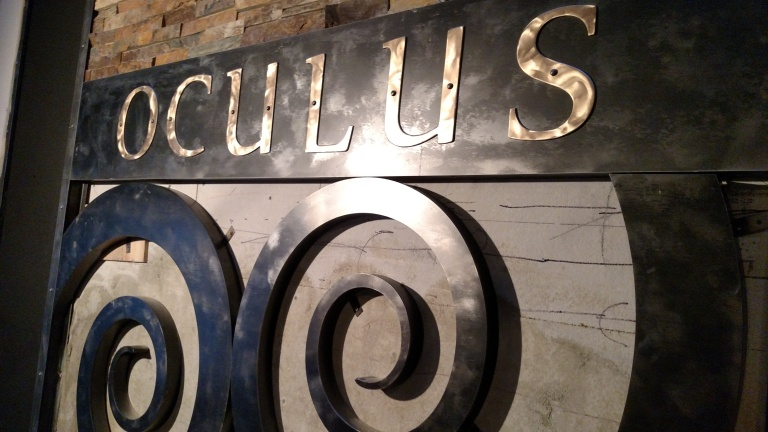 Bronze letters mounted on patinated steel.